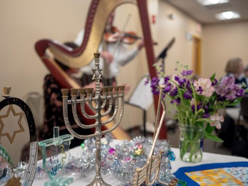 A menorah and music at the Family Table Chanukah Celebration