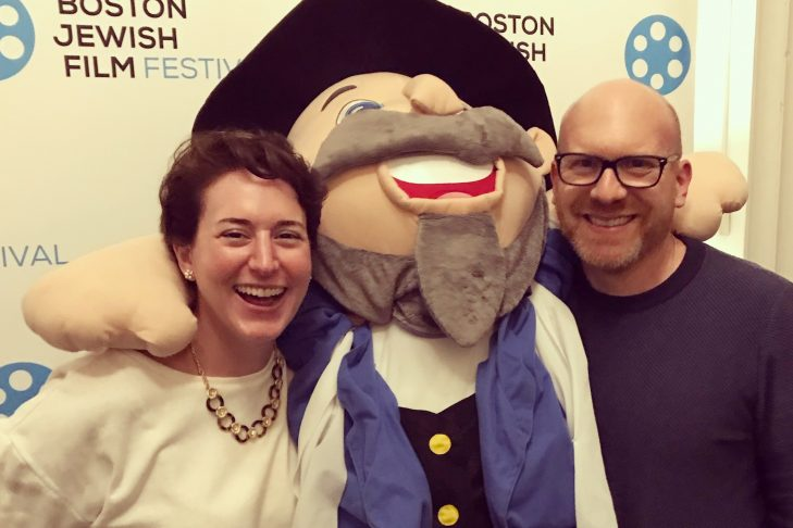 "JewishBoston's Kali Foxman and CJP's Dan Seligson with ""The Mensch on a Bench"" at the ""Heading Home"" premiere (Courtesy photo)"
