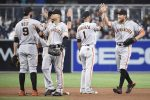 REFERRAL: SAN DIEGO, CALIFORNIA - SEPTEMBER 22: San Francisco Giants players celebrate after beating the San Diego Padres 2-1 in a baseball game at PETCO Park on September 22, 2016 in San Diego, California. (Photo by Denis Poroy/Getty Images)
