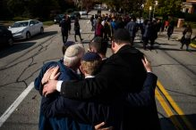 Mourners embrace at the funeral of Joyce Fienberg who was killed at the mass shooting at the Tree of Life Synagogue on Oct. 31, 2018, in Pittsburgh, PA. Mourners embrace at the funeral of Joyce Fienberg who was killed at the mass shooting at the Tree of Life Synagogue on Oct. 31, 2018, in Pittsburgh, PA. (Salwan Georges—The Washington Post/Getty Images)