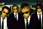 "Tico Torres, David Bryan, Jon Bon Jovi and Richie Sambora from the 2000 album cover ""Crush"" (Promotional image)"