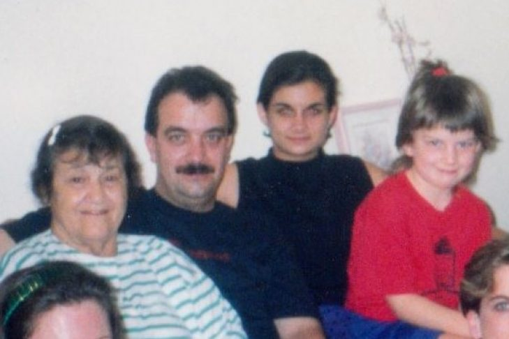 Emilia (in red) with her grandmother, father and cousin (Courtesy photo)