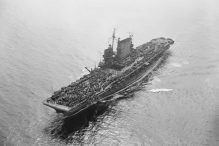 REFERRAL USE ONLY. The USS Saratoga aircraft carrier with the US Pacific Fleet, sails through San Francisco's Golden Gate as part of the 3,800 crew crowds her flight deck on Sept. 13, 1945. (AP Photo/Ernest K. Bennett)