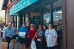 Chaverim Shel Shalom participants outside Barry's Village Deli (Courtesy photo)