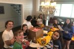 Ava and her friends join to make backpack kits (Courtesy photo)