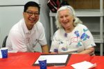 A volunteer sitting with a guest at a memory cafe (Courtesy photo)