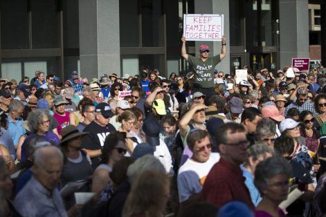 People gathered Sunday for the protest outside the John F. Kennedy Federal Building in Boston.(NIC ANTAYA FOR THE BOSTON GLOBE)