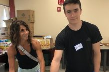 Jeremy Lawrence and his mother volunteer at a Family Table distribution (Courtesy photo)