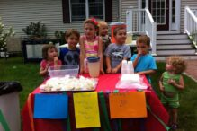 A group of kids fundraising for JF&CS Family Table with a lemonade stand (Courtesy photo)