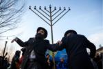 Rabbis Yosef Zaklos (left) and Chaim Prus danced at Sunday's celebration.NIC ANTAYA FOR THE BOSTON GLOBE