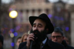 BOSTON. - DECEMBER 22: Rabbi Yosef Zaklos  seeks to the crowd during the 36th Annual Menorah lighting in the Boston Common on December 22, 2019 in Boston, MA. (Staff Photo By Nancy Lane/MediaNews Group/Boston Herald)