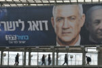 Blue and White political party election billboard with an image of Benny Gantz, party leader, in front of Benjamin Netanyahu, Israeli PM and Likud Party leader, seen in Ramat Gan.Israelis head to the polls for the third election in less than a year on March 2nd. On Tuesday, February 25, 2020, in Ramat Gan, Tel Aviv District, Israel. (Photo by Artur Widak/NurPhoto)