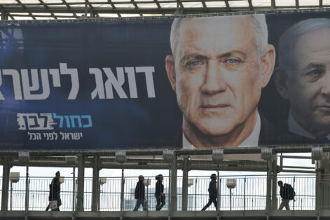 Blue and White political party election billboard with an image of Benny Gantz, party leader, in front of Benjamin Netanyahu, Israeli PM and Likud Party leader, seen in Ramat Gan.