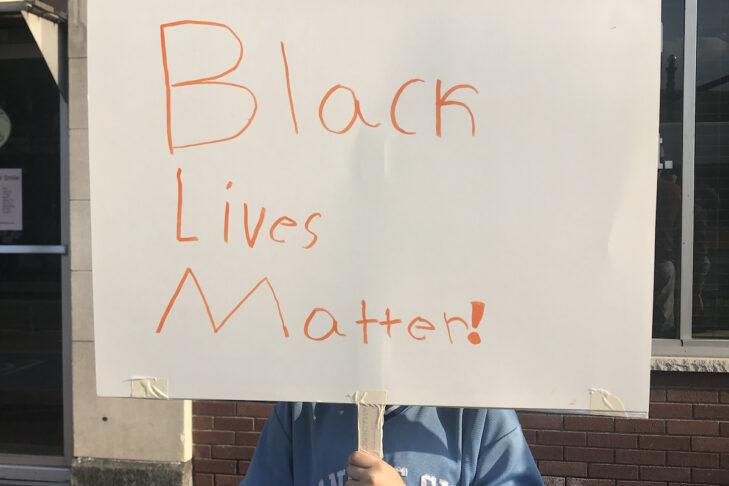Kara's 9-year-old son at his first protest (Photo: Kara Baskin)