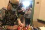 A staff member picks out goodies to deliver to residents (Courtesy photo)