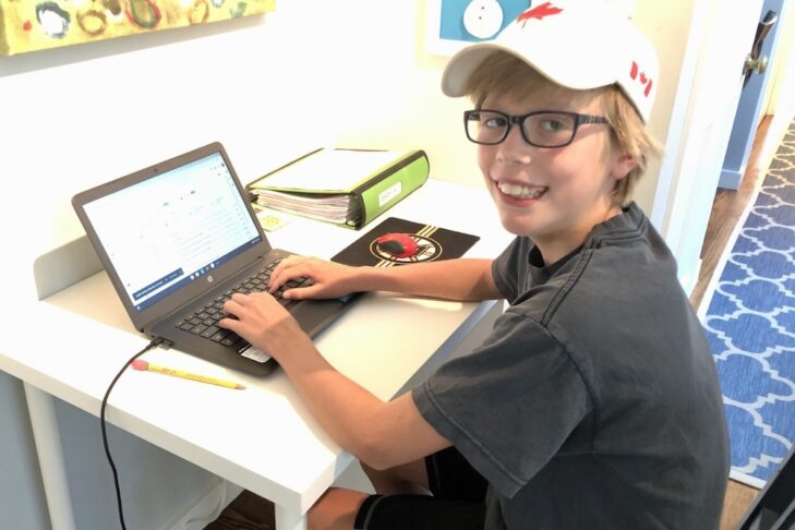 A boy remote learning at home