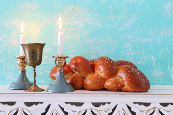 shabbat image. challah bread, shabbat wine and candles