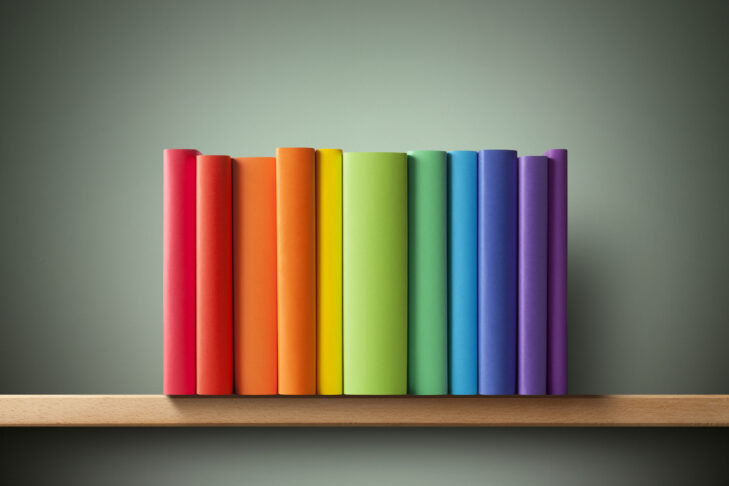 Colored books on the shelf.