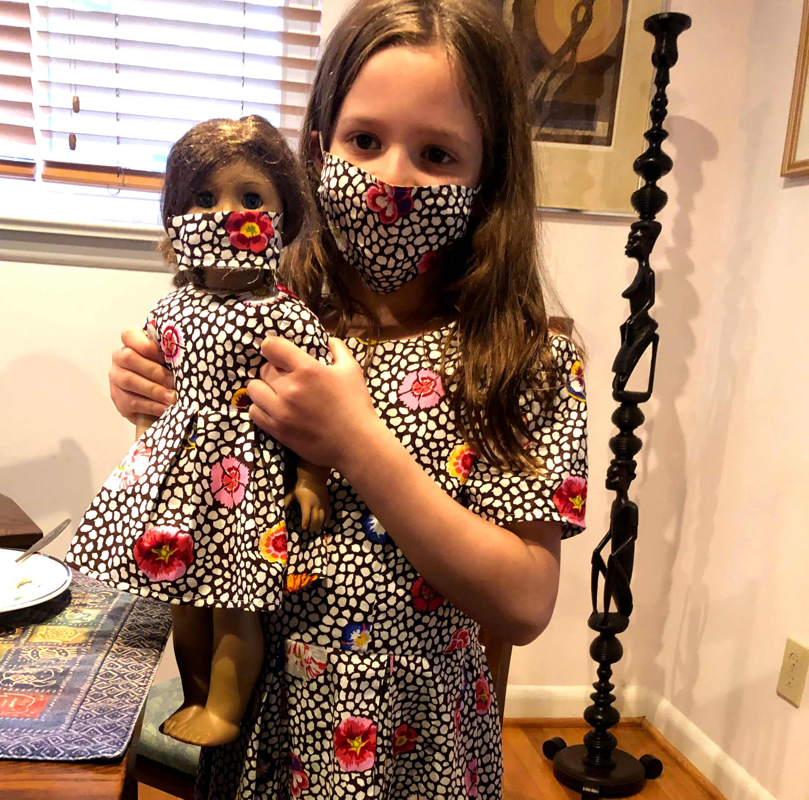 Gali Feinberg and her doll in matching dresses made by her grandmother (Courtesy photo)