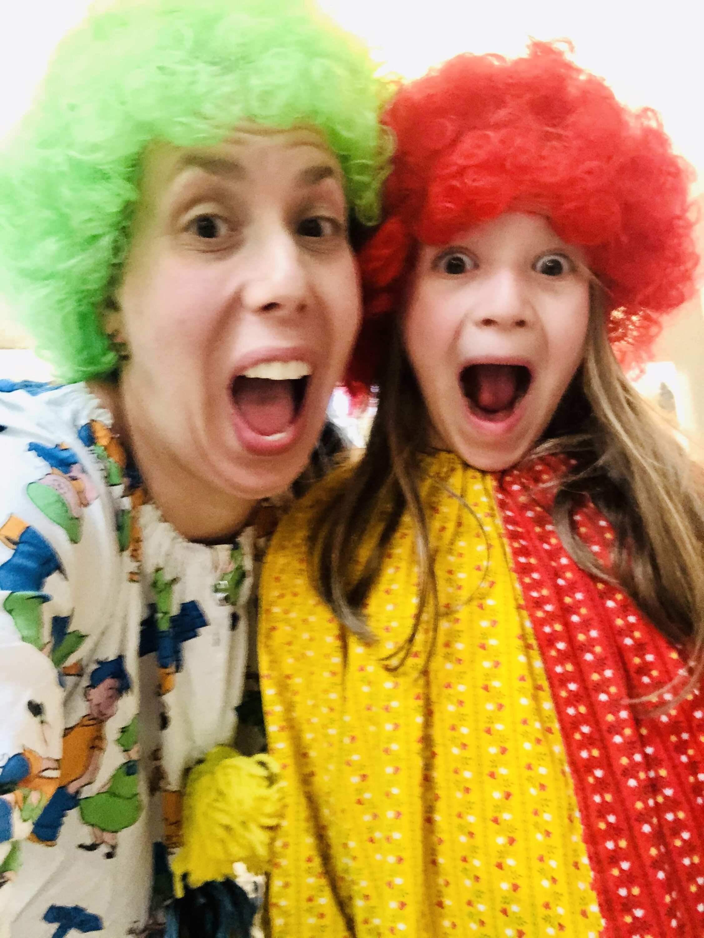 "Sarah Feinberg and her daughter, Gali, dressed as clowns for ""Silly Shabbat"" at home (Courtesy photo)"