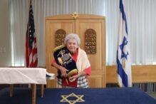 Shirley Sowsy 91 Bat Mitzvah holding a Torah