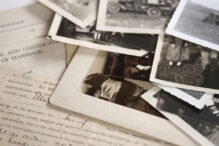 Genealogy family history theme with old family photos and documents.