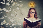 Woman student reading a book has a bright idea how to earn money