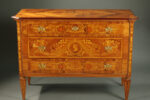 Italian NeoClassical style chest of drawers/dresser with wood inlay and brass pulls.