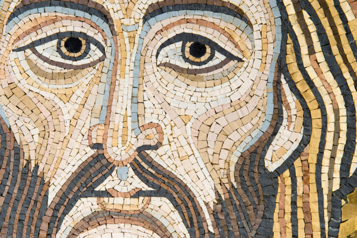 Mosaic representing Christ's Face, in byzantine style. Golden background. It is modern, made by a Sicilian artist, and looks like the Blessing Christ of the Monreale Cathedral or Cefalu' one. The background is made of golden leaf. This image is characteristic for its uniqueness.