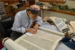 Commandment 613 – Rabbi Kevin Hale restoring a scroll