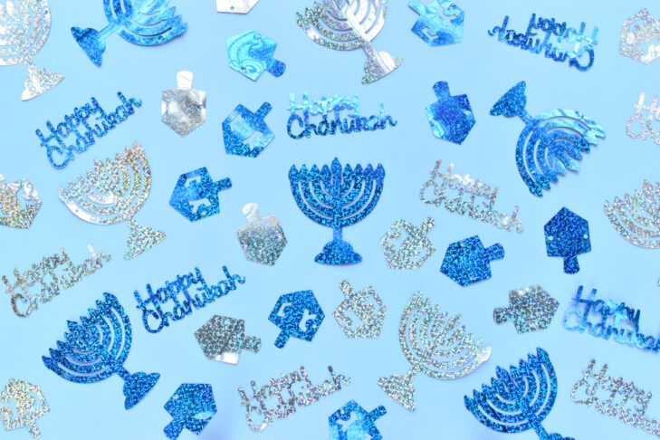 Happy Chanukah decorations on a blue background