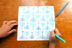 POV of a child drawing a Menorah shapes on a card for Hannukah Jewish  Jewish holiday.POV of a child drawing a Menorah shapes on a card for Hannukah Jewish  Jewish holiday.
