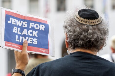 "A man wearing a kippah holds a sign reading ""Jews for Black Lives"" at the weekly Black Lives Matter ""Jackie Lacey Must Go!"" protest in front of the Hall of Justice in Los Angeles, California, September 9, 2020. - The protesters gather weekly outside the office of LA District Attorney Jackie Lacey to protest ""her refusal to prosecute violent officers."" (Photo by VALERIE MACON / AFP)"