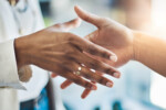 Closeup shot of two businesswomen shaking hands in an office