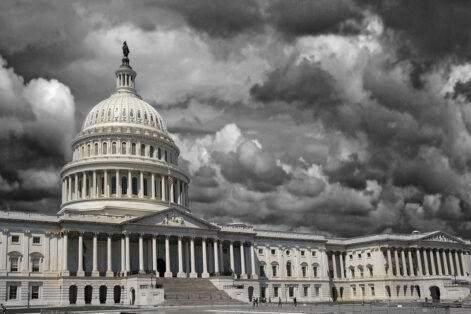 The United States Capitol in Washington DC with dark storm clouds