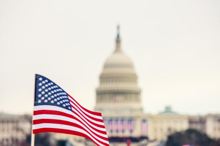 Presidential Inauguration.  Flag waves at Washington Mall near the capital.
