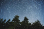 The stars spin around Earth's North Celestial Pole very near the North Star, Polaris.  Long exposure.