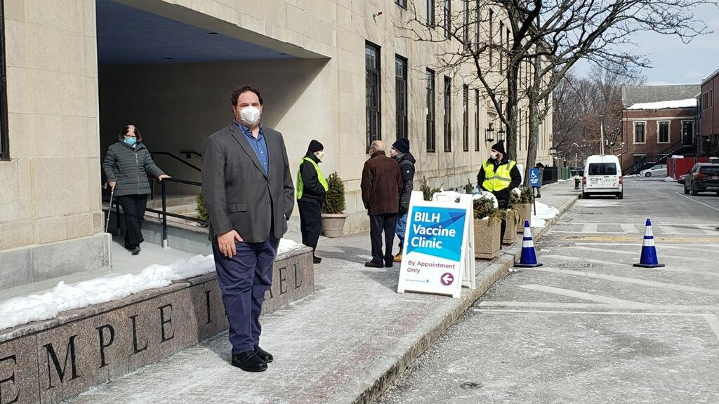 Dan Deutsch, executive director of Temple Israel, at the vaccine clinic entrance (Courtesy Temple Israel)