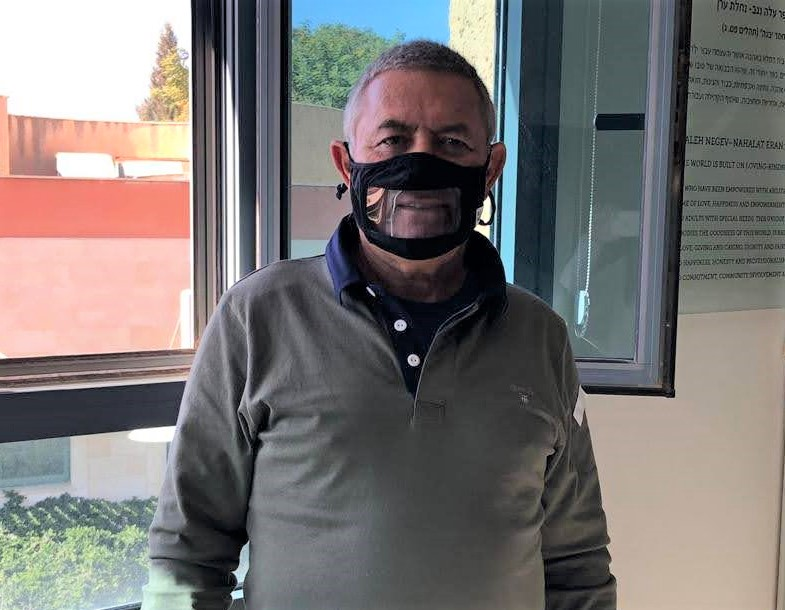 "Adi Negev founder Doron Almog wears a ""smile mask"" (Courtesy photo)"