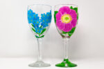 Two wine glasses with flowers paintings.