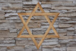 Star of David fixed on a stone wall of a synagogue
