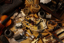 A mixture of antiques and collectables on a wooden floor. Click on the link below to see more of my antiques and collectable images.