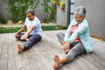 Shot of a happy older couple practicing yoga together outdoors