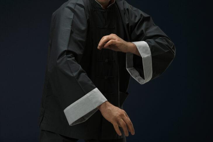 Tai Chi. Man in kimono excercising martial arts.