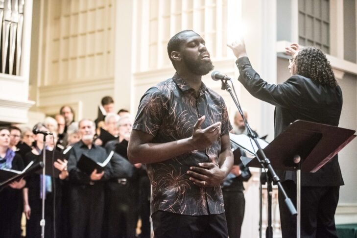 Anthony Russell (front) and Derek David (right) perform with A Besere Velt Yiddish Chorus in 2019 (Photo: Derek Kouyoumjian)