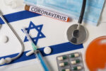 Coronavirus, nCoV concept. Top view of a protective breathing mask, stethoscope, syringe, pills on the flag of Israel. A new outbreak of the Chinese coronavirus