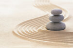 Zen garden with stack of stones in raked sand