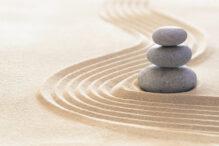 Zen garden with stack of stones in raked sand
