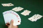Hand holding cards ready to play bridge