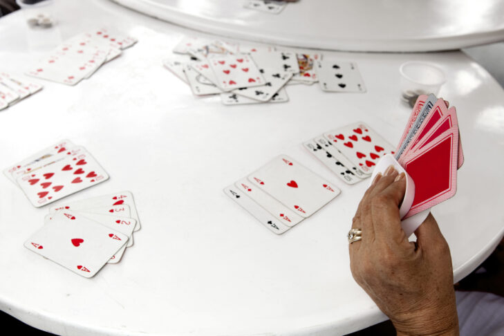 Looking down at a card table while people are playing gin rummy.  Shot with Canon 5D Mark 3.  rr